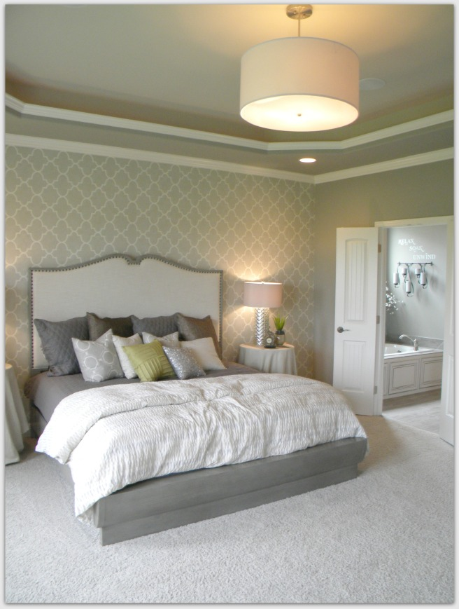 This bedroom was an inspiration for my own... when I redecorate I would love something fresh like this with my own accents.  The color is gray... not as green in person.  :)